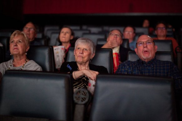Some members of the Capital City Village watching a movie in Austin.  Photo: Ilana Panich-Linsman for The New York Times