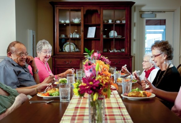 Seniors around the communal table at a Green House (Credit: THE GREEN HOUSE PROJECT)